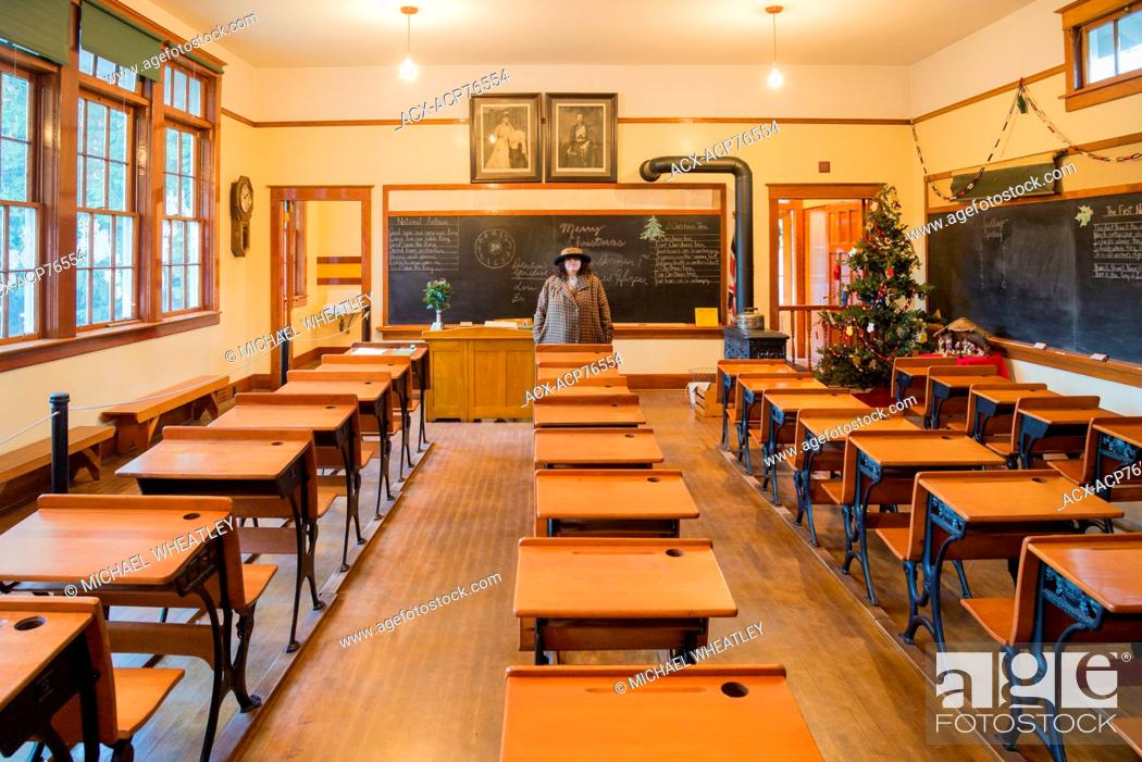 Stock Photo: Heritage School room with teacher, Burnaby Village Museum, Burnaby, British Columbia, Canada.