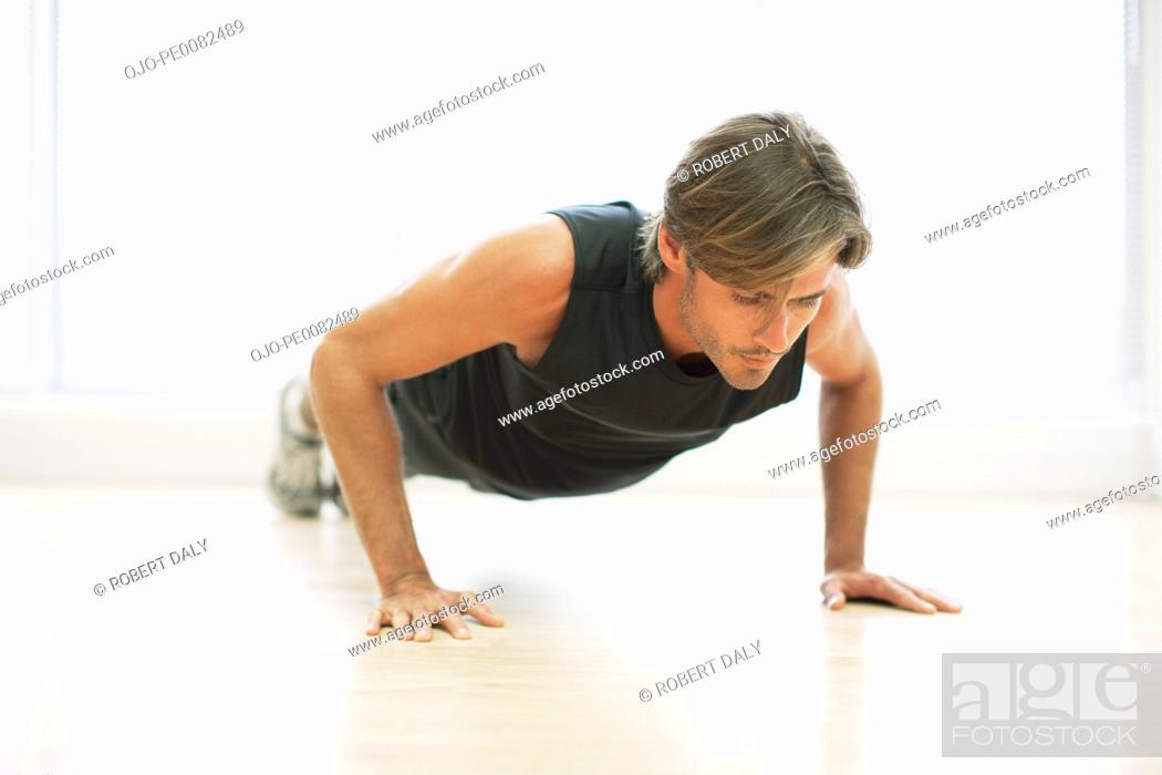 Stock Photo: Man doing push-ups.