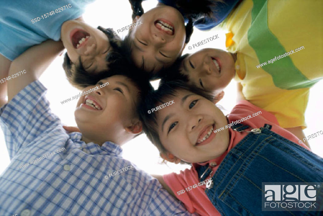 Stock Photo: Low angle view of a group of children in a huddle.