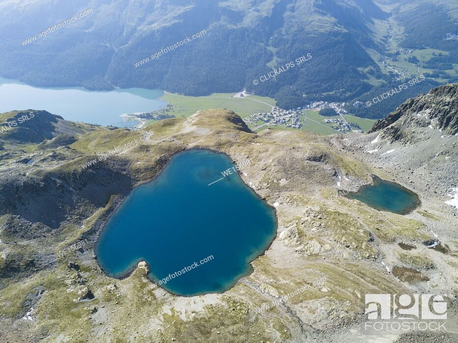 Imagen: Aerial view of the blue water of Lej da la Tscheppa, St. Moritz, Engadine, canton of Graubünden, Switzerland, Europe.