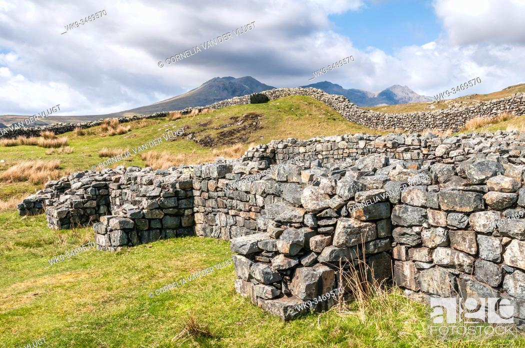 Stock Photo: Scenic view of the Hardknott Roman Fort in the English Lake District with the Scafell Mountain Range in the background.