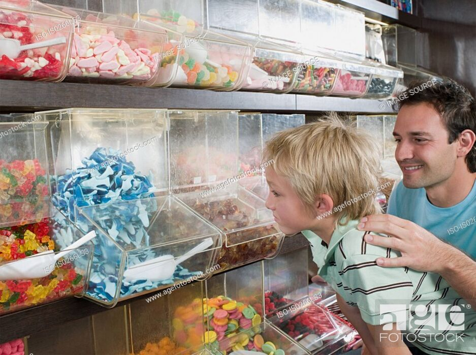 Stock Photo: A father and son choosing sweets.