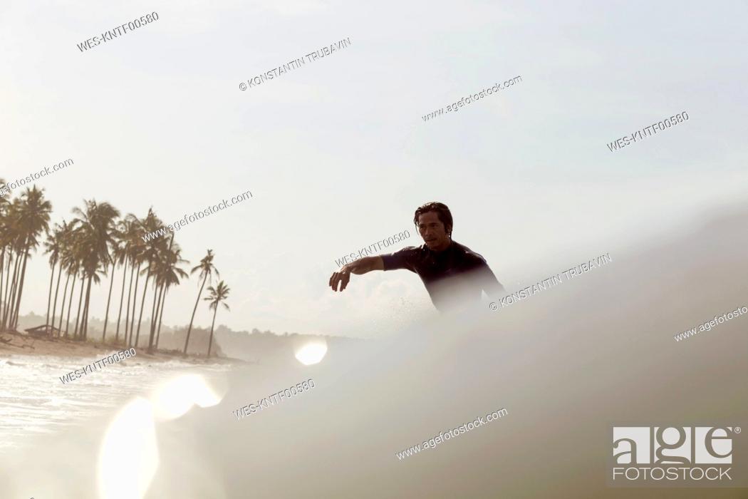 Photo de stock: Indonesia, Bali, surfer in the sea.