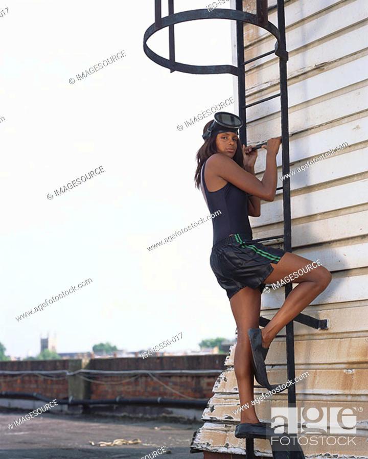 Stock Photo: Female diver climbing ladder.