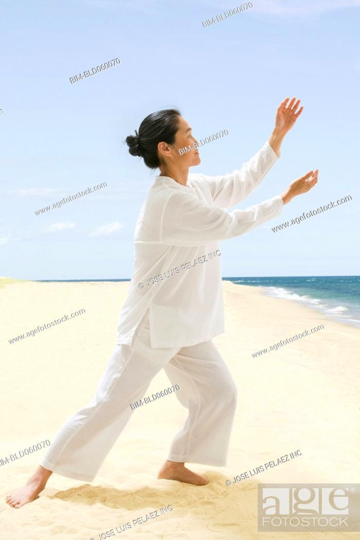 Stock Photo: Asian woman practicing tai chi.