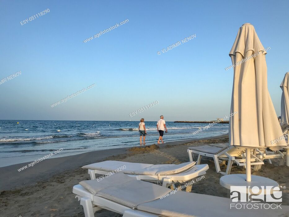 Stock Photo: Pomorie, Bulgaria - July 03, 2019: People Relaxing On The Beach.