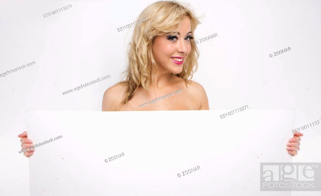 Stock Photo: topless girl holding blank sign board over white.