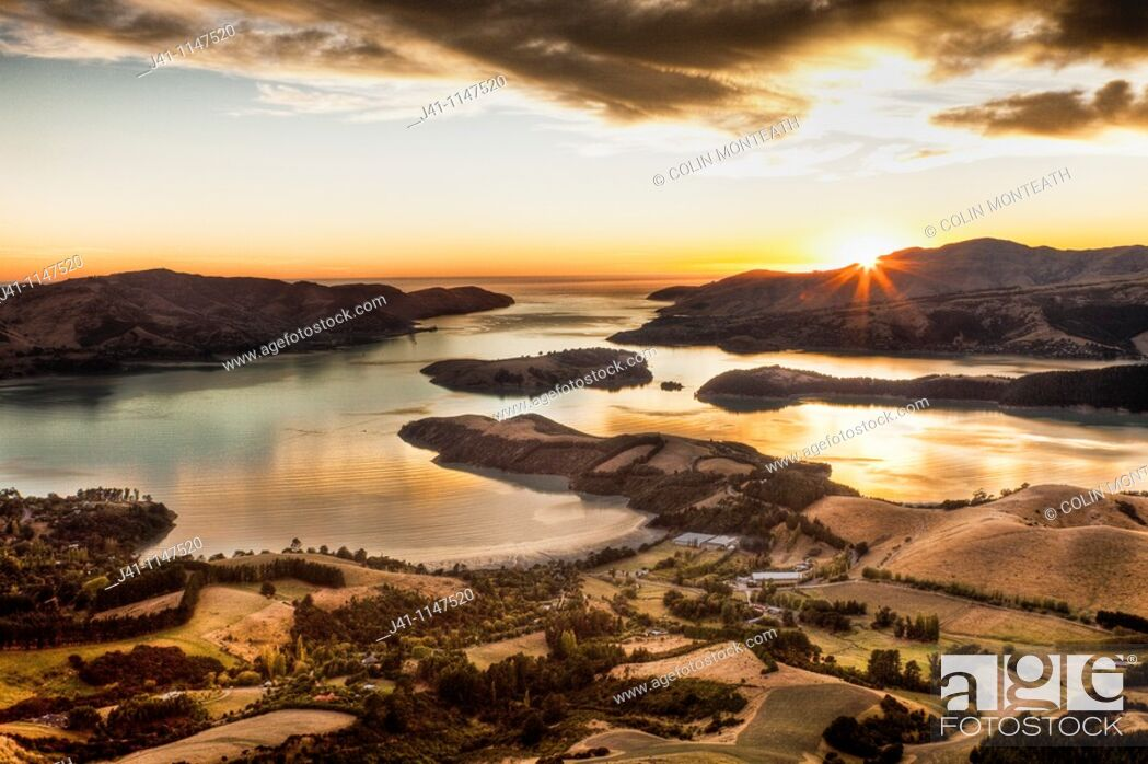 Stock Photo: Lyttelton harbour at dawn from Summit road above Christchurch, Canterbury, New Zealand.