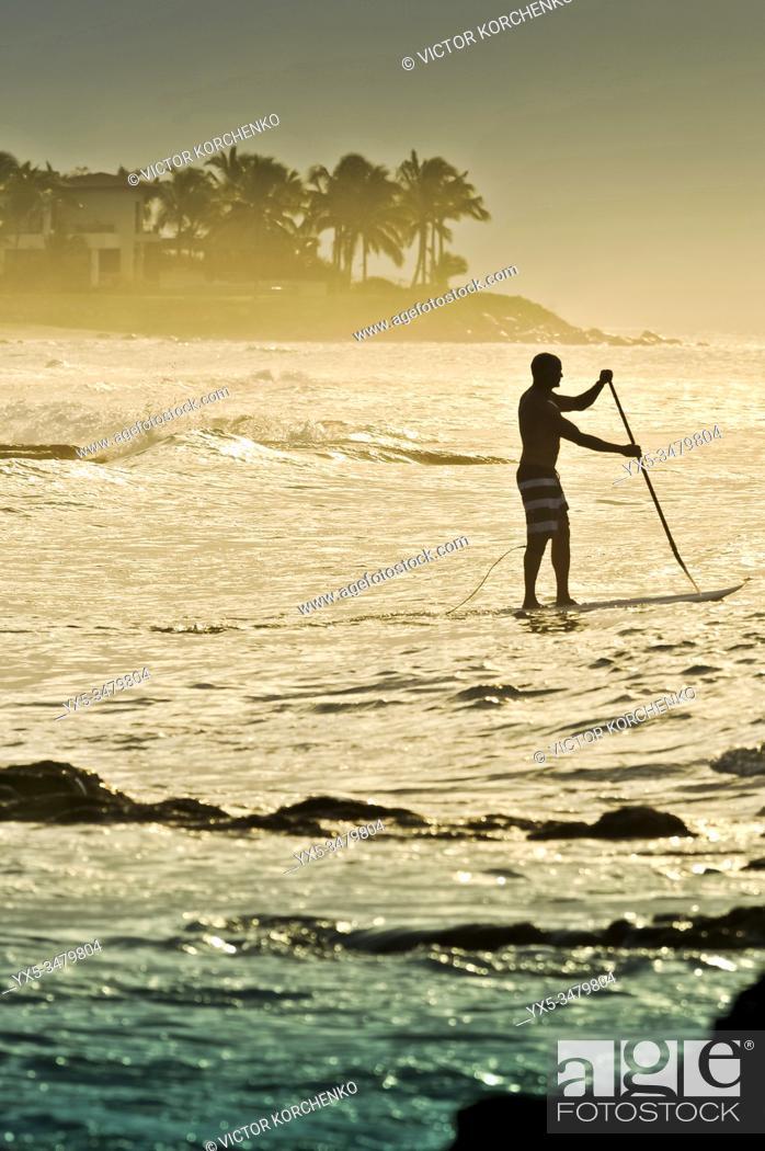 Photo de stock: Paddleboarding on a beach near Puerto Vallarta, Mexico.