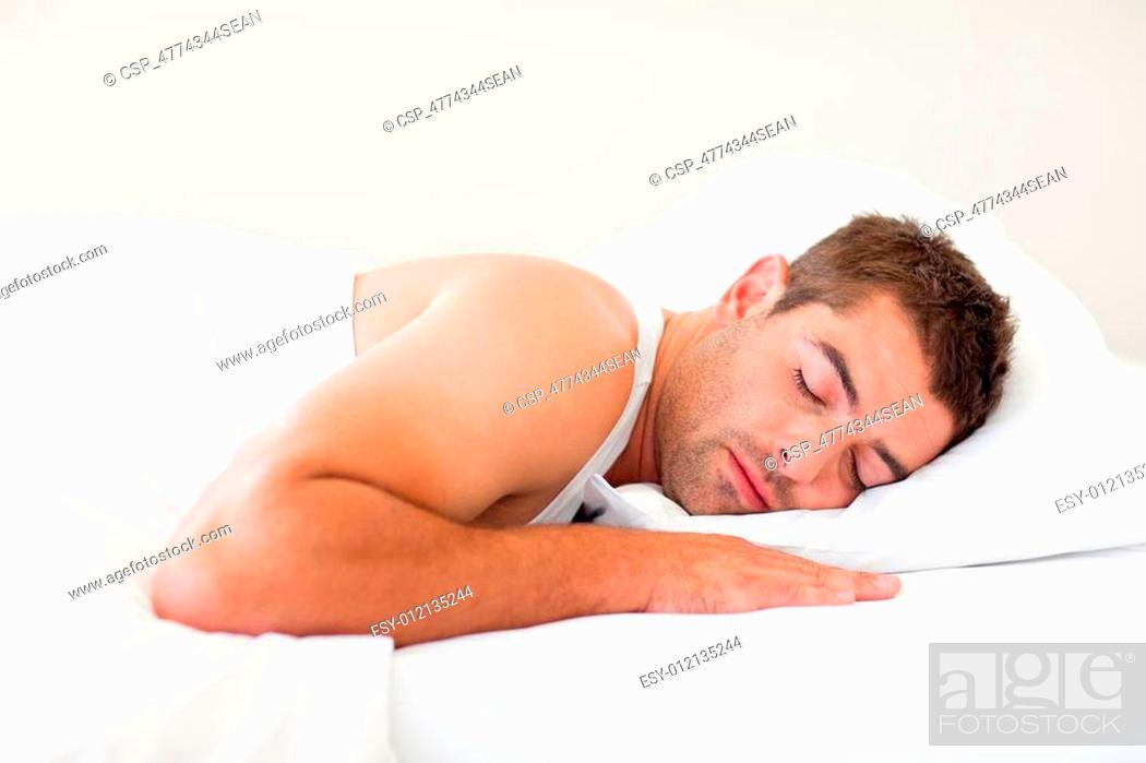 Stock Photo: Man sleeping in bed.