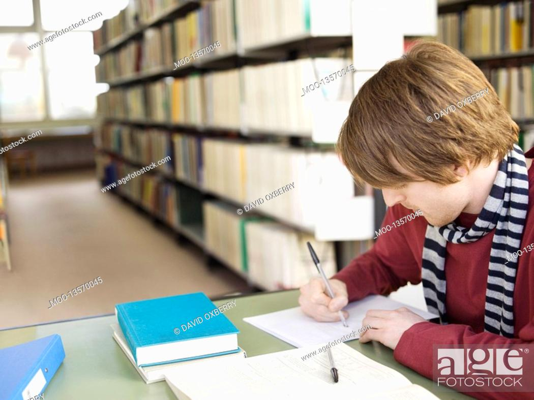 Stock Photo: Student at library.