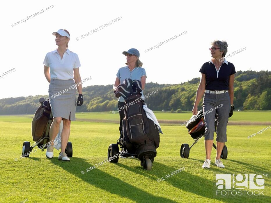 Stock Photo: Three women on fairway.