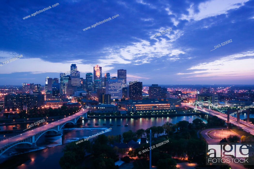 Stock Photo: Evening city skyline scene from St. Anthony Main. Minneapolis. Minnesota. USA.