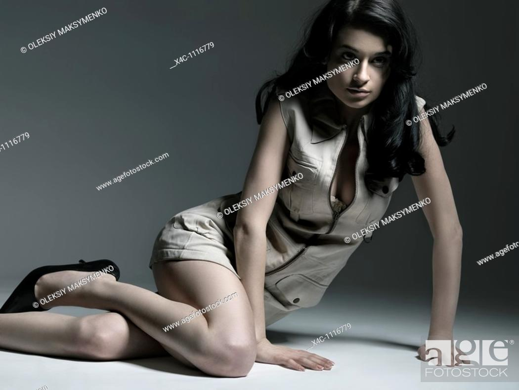 Stock Photo: Young beautiful woman in short deerskin dress fashion photo.
