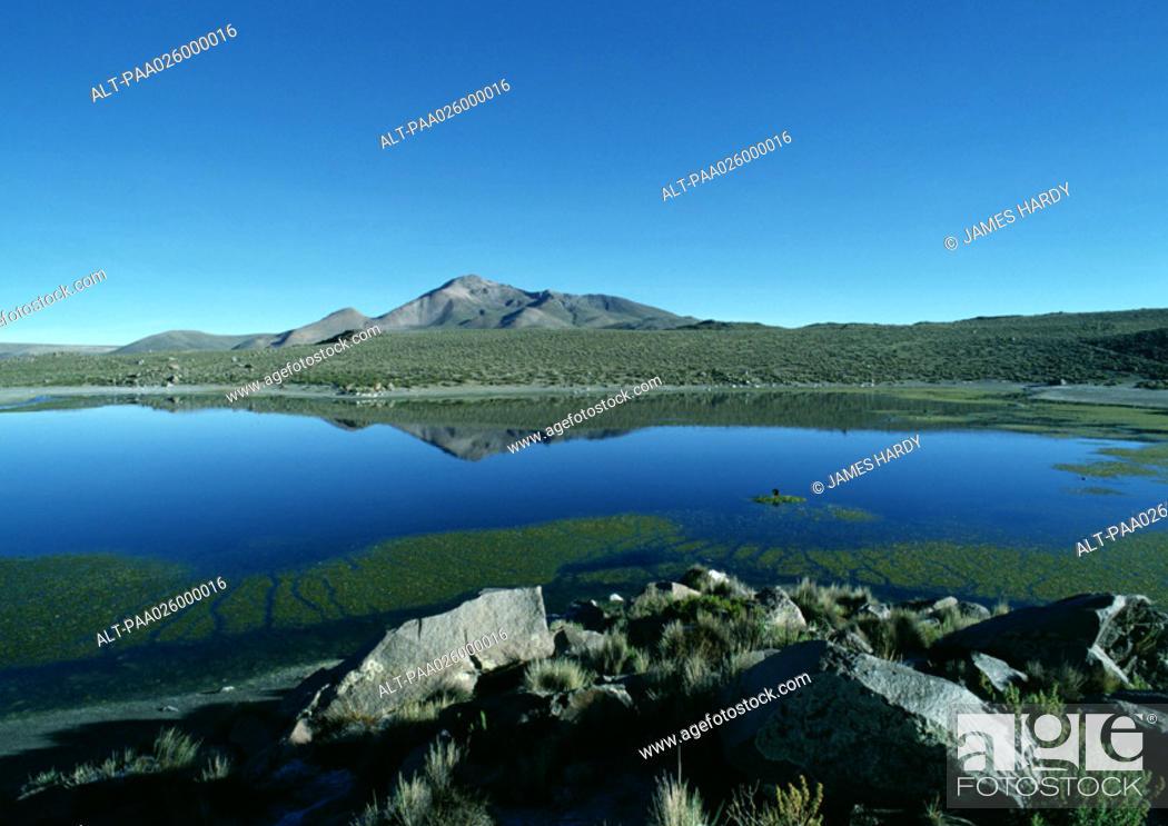 Stock Photo: Chile, El Norte Grande, lakescape with mountain in distance.