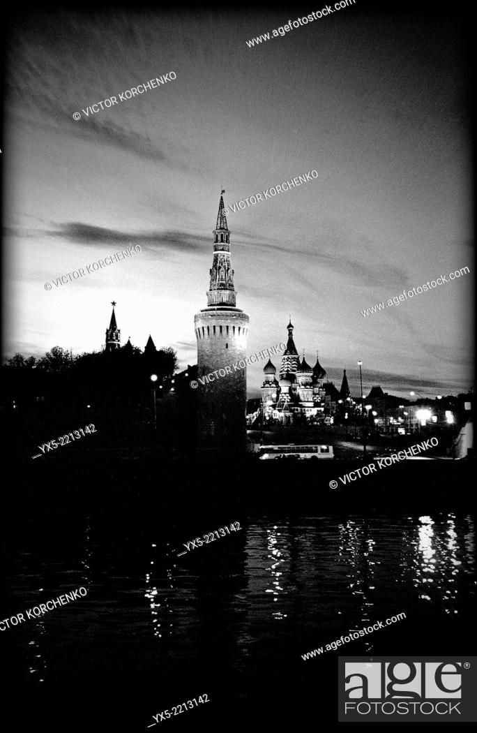Stock Photo: Kremlin and St. Basil's Cathedral at night seen across Moskva River, Moscow.