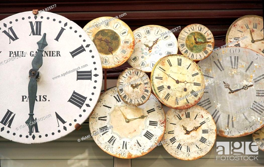 Stock Photo: Old clocks at watchmakers's shop façade, Vannes. Brittany, France.