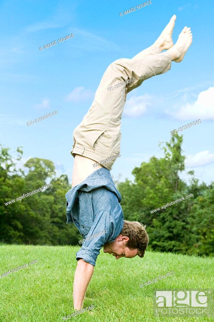Stock Photo: Man doing a handstand.