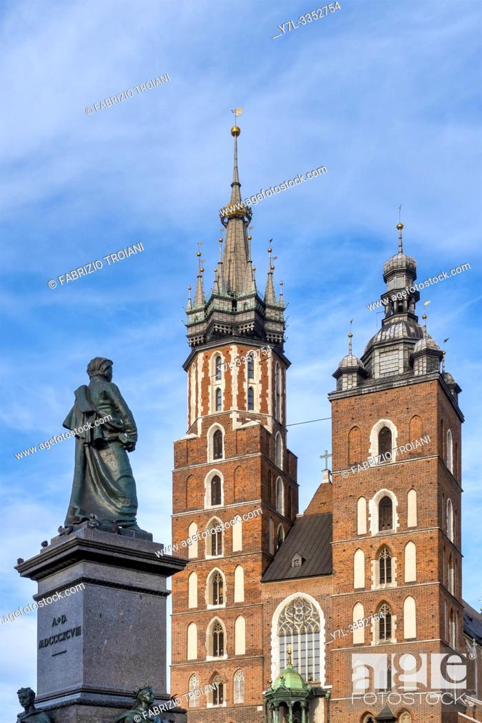 Stock Photo: Adam Mickiewicz Monument and Saint Mary Basilica, Krakow, Poland.