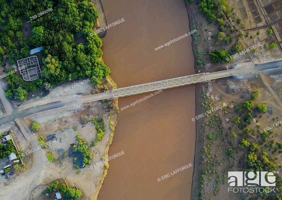 Stock Photo: Aerial view of the metal bridge over Omo river, Omo Valley, Omorate, Ethiopia.