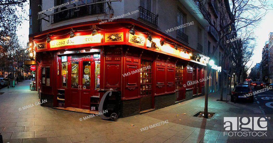 Stock Photo: Tavern, night view. Alcantara street corner to Juan Bravo street, Madrid, Spain.
