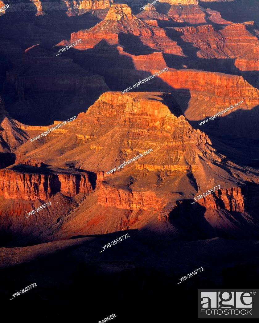 Stock Photo: USA, Arizona, Grand Canyon National Park, South Rim, Sandstone buttes below Hopi Point redden at sunset.