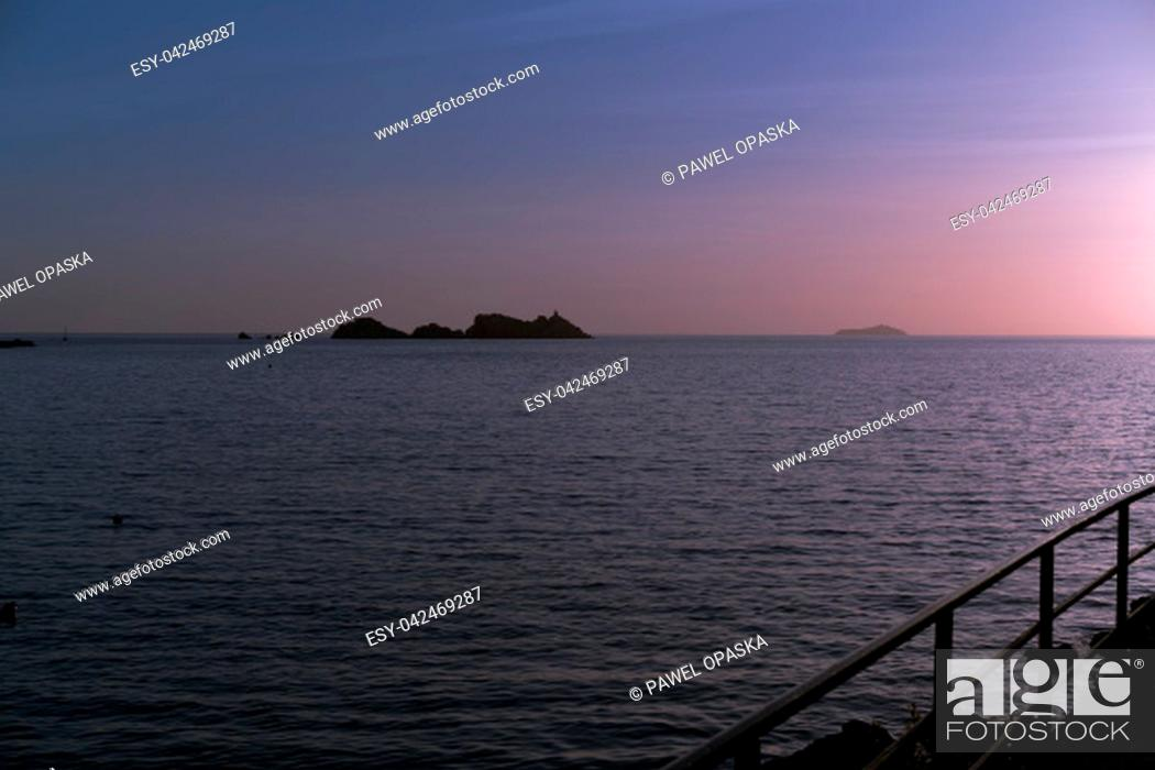 Stock Photo: Sunset over the rocky Croatian coast in Dubrovnik, Croatia.