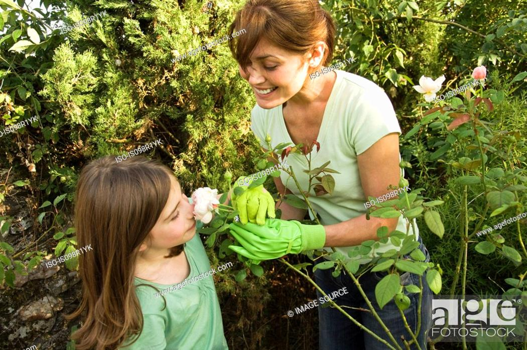 Stock Photo: Mother and daughter in garden.