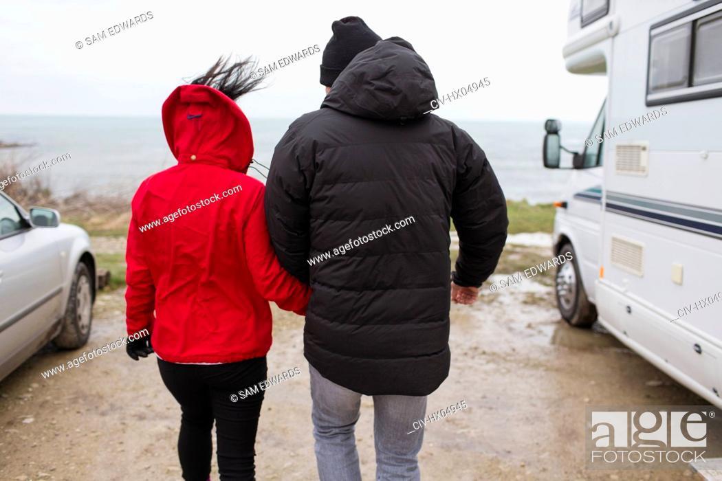 Stock Photo: Couple walking outside motor home.