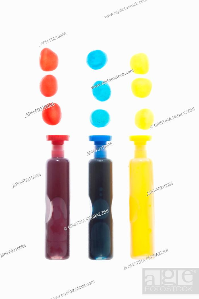 Stock Photo: Three containers with coloured liquid spots.
