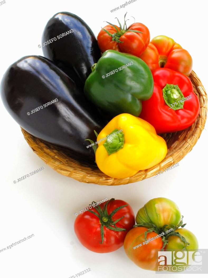 Stock Photo: Basket with aubergines, tomatoes and peppers.