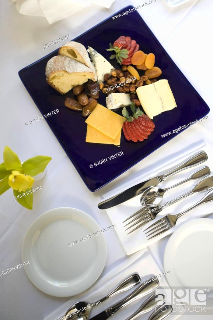 Stock Photo: Fruit and cheese platter on table.