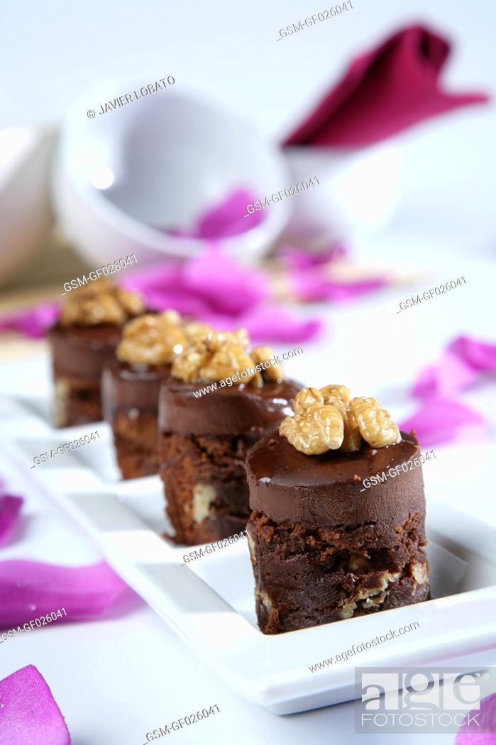 Stock Photo: Sponge cake with chocolate and walnuts.