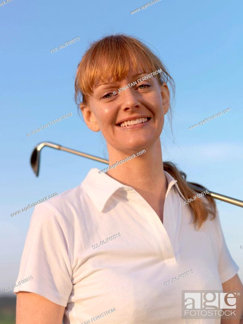 Stock Photo: Woman with golf club.