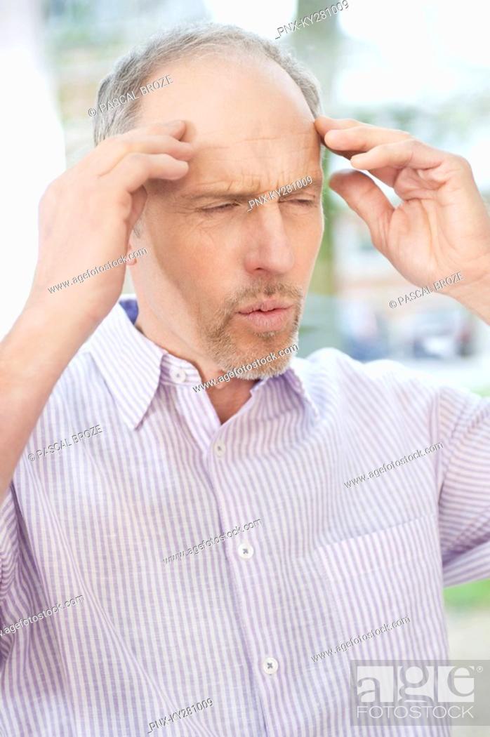 Stock Photo: Man suffering from a headache.