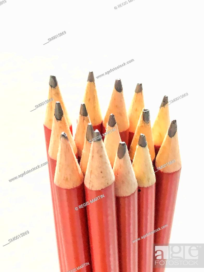 Stock Photo: Bunch of red lead pencils against a white background.