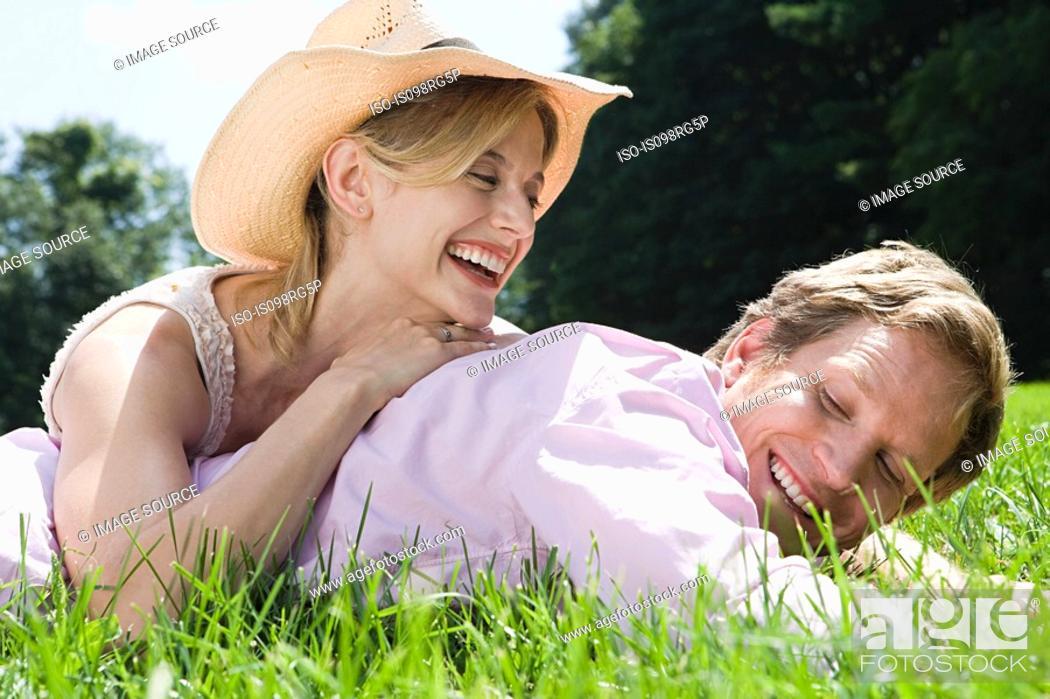 Stock Photo: Couple lying in field.