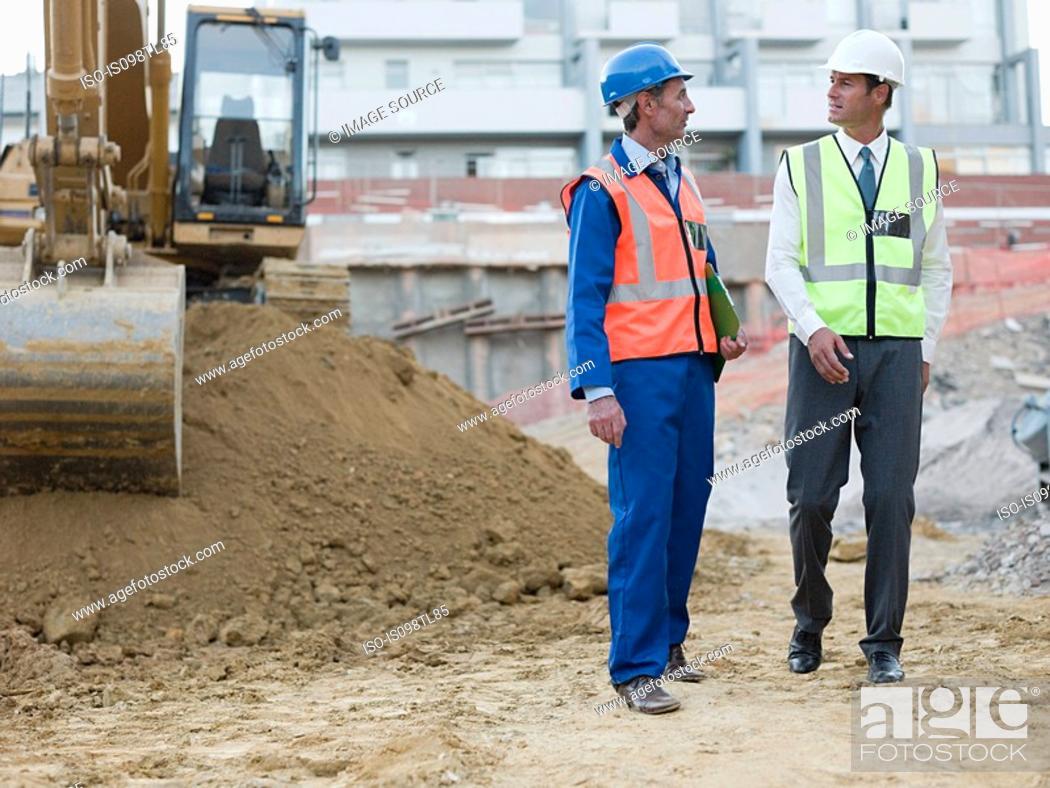 Stock Photo: Mature men meeting on construction site.