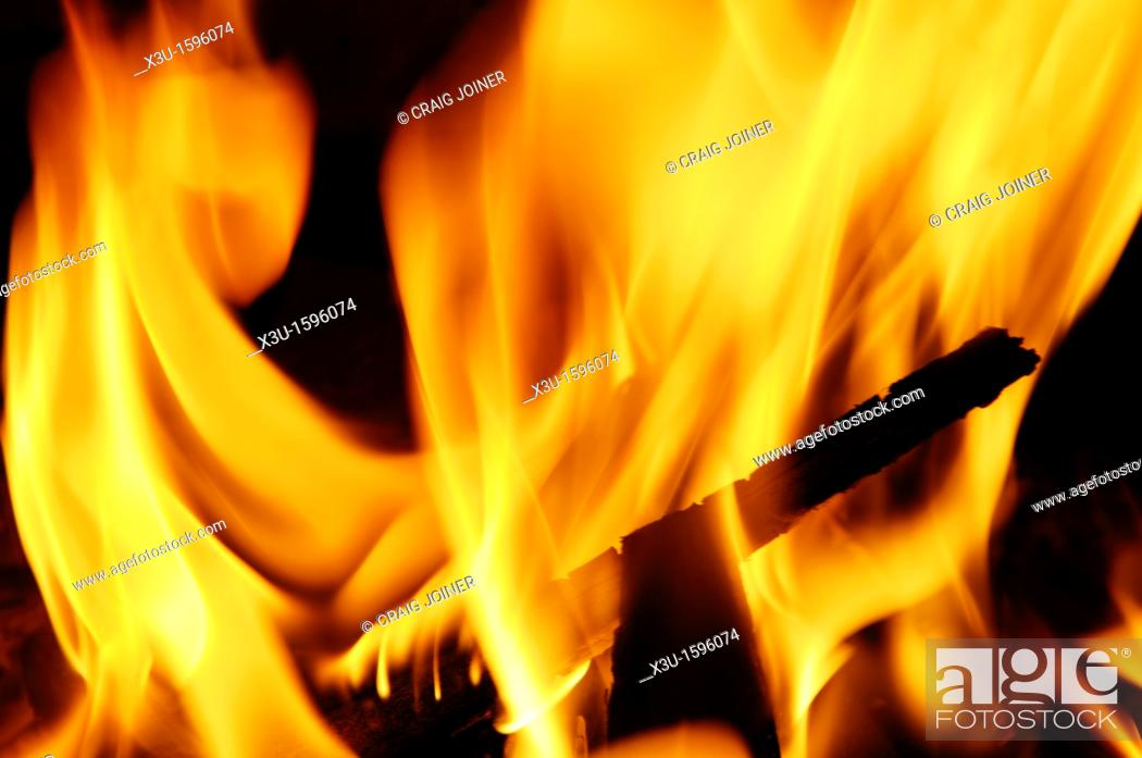 Stock Photo: Orange flames from a small wood bonfire.