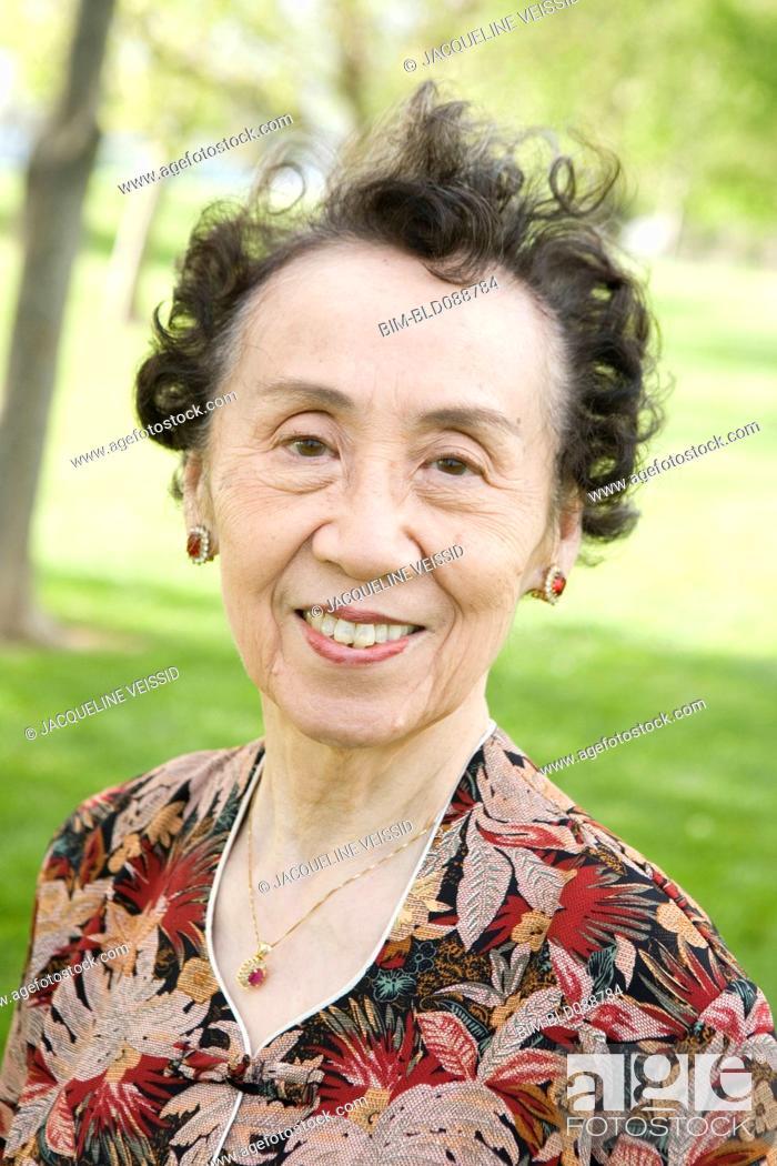 Stock Photo: Smiling senior Chinese woman.