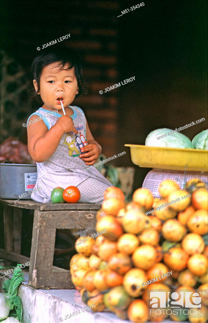 Young Baby Girl In A Fruit Market Bali Indonesia Stock Photo
