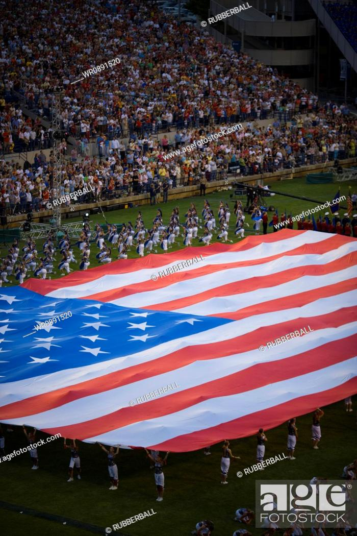 Stock Photo: High angle view of a group of people holding a large American Flag.