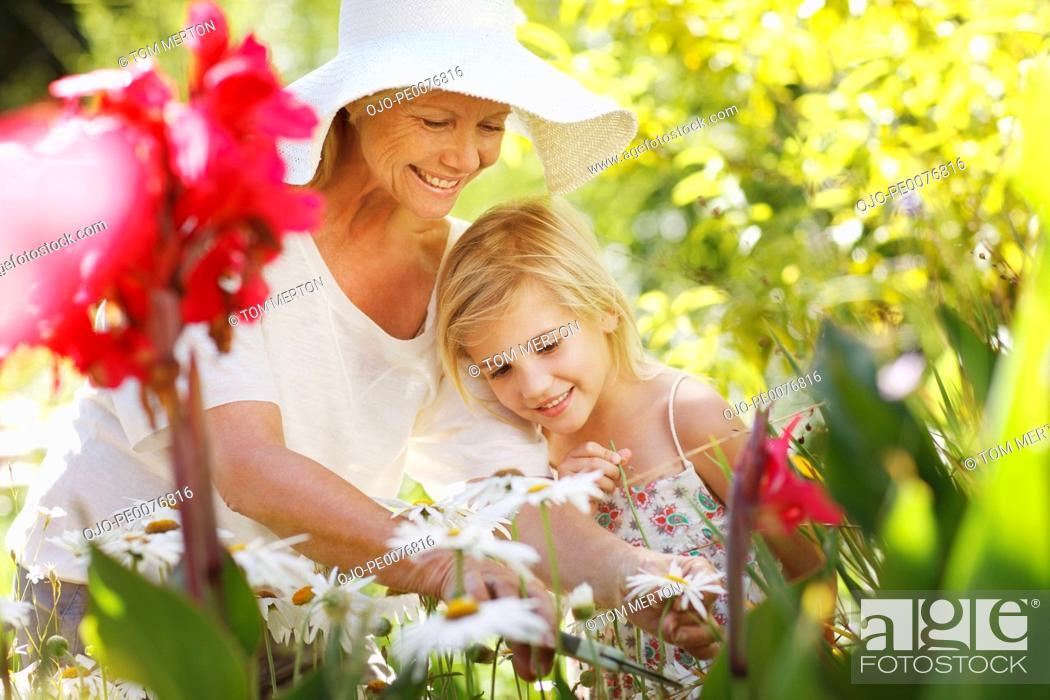 Stock Photo: Grandmother and granddaughter in garden.