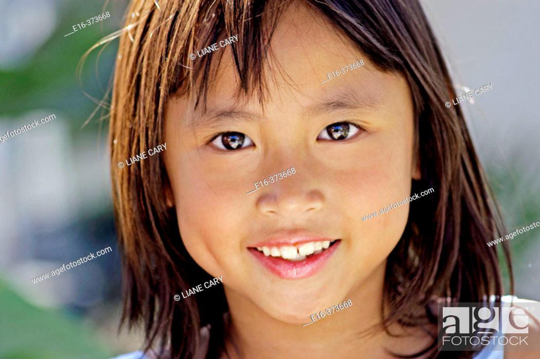 Stock Photo: smiling Asian girl.
