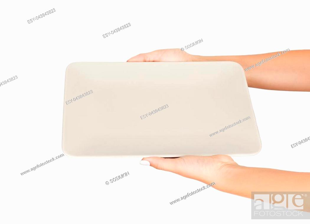 Photo de stock: Blank white matte rectangular plate in female hand. perspective view, isolated on white background.