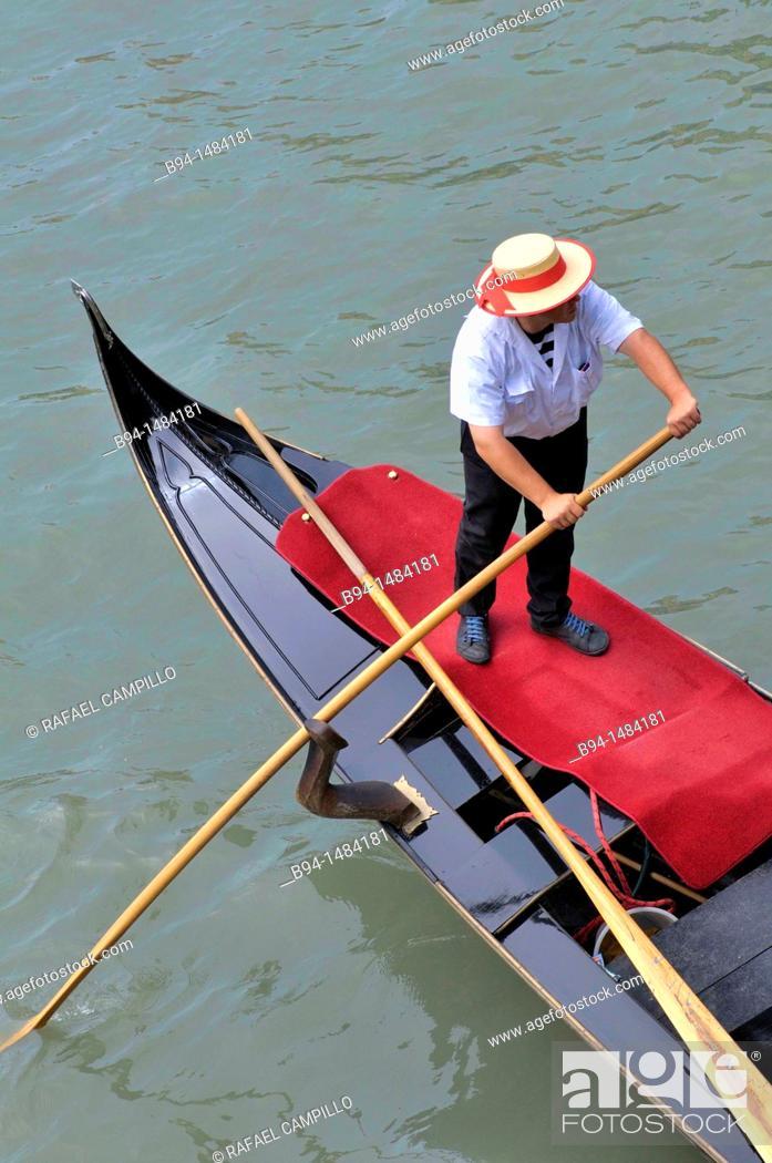 Stock Photo: Gondola and gondolier in the Grand Canal, Venice, Veneto, Italy.