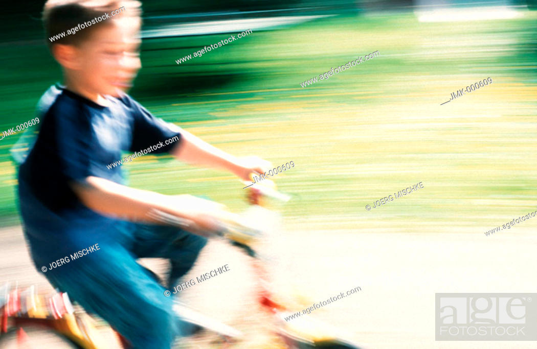 Stock Photo: A little boy riding a bicycle, driving a cycle.