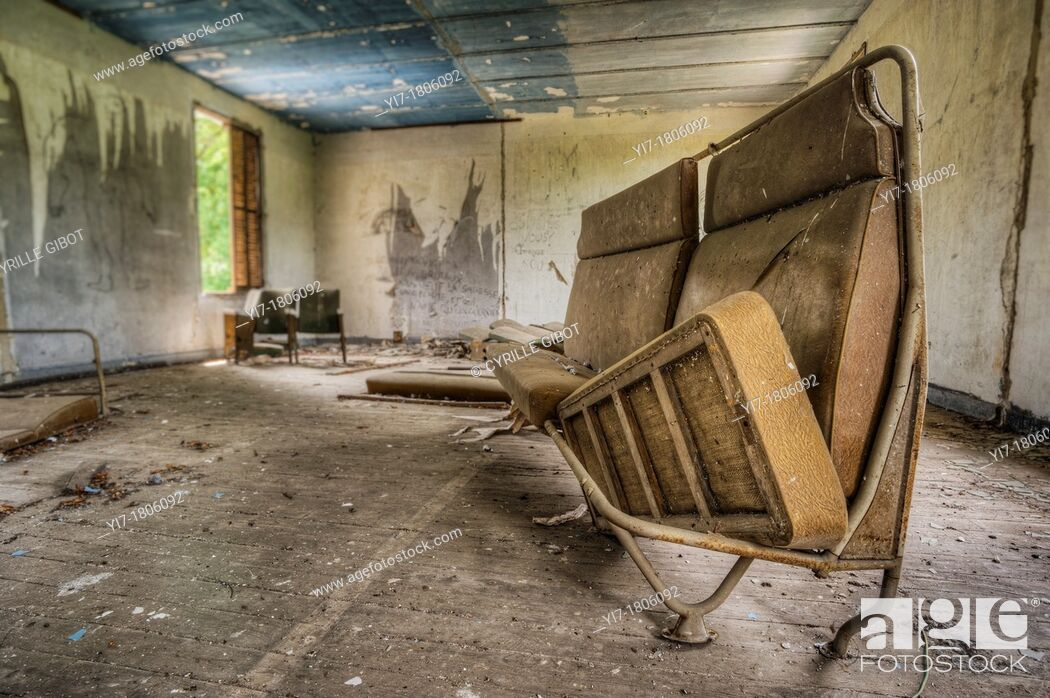 Stock Photo: Abandoned house interior with old couch.