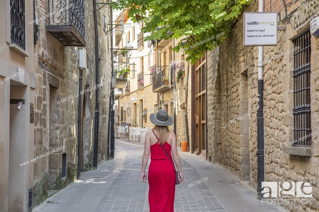Stock Photo: Tourist woman walking down street in Laguardia Rioja alavesa wine route. Alava. Basque country. Spain.