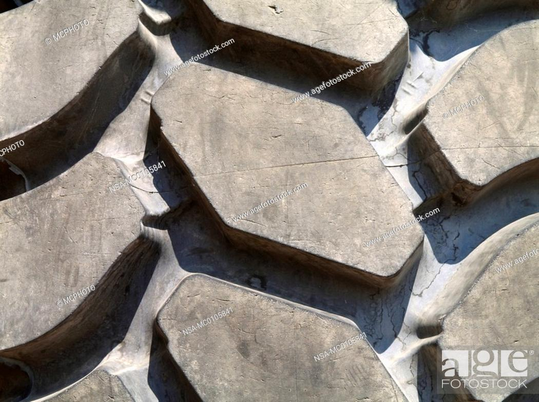 Stock Photo: tread of a big wheels of an excavator for surface mining.